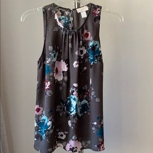 Floral blouse tank with dark gray background